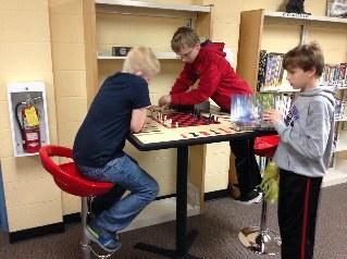 Boys ar game table (319x238).jpg